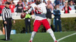 November 29, 2014: North Carolina State Wolfpack quarterback Jacoby Brissett (12) looks up up field for an open receiver during the NCAA football game between the North Carolina State Wolfpack and the North Carolina Tar Heels at Kenan Memorial Stadium in Chapel Hill, N.C.  The Wolfpack won the game, 35-7.